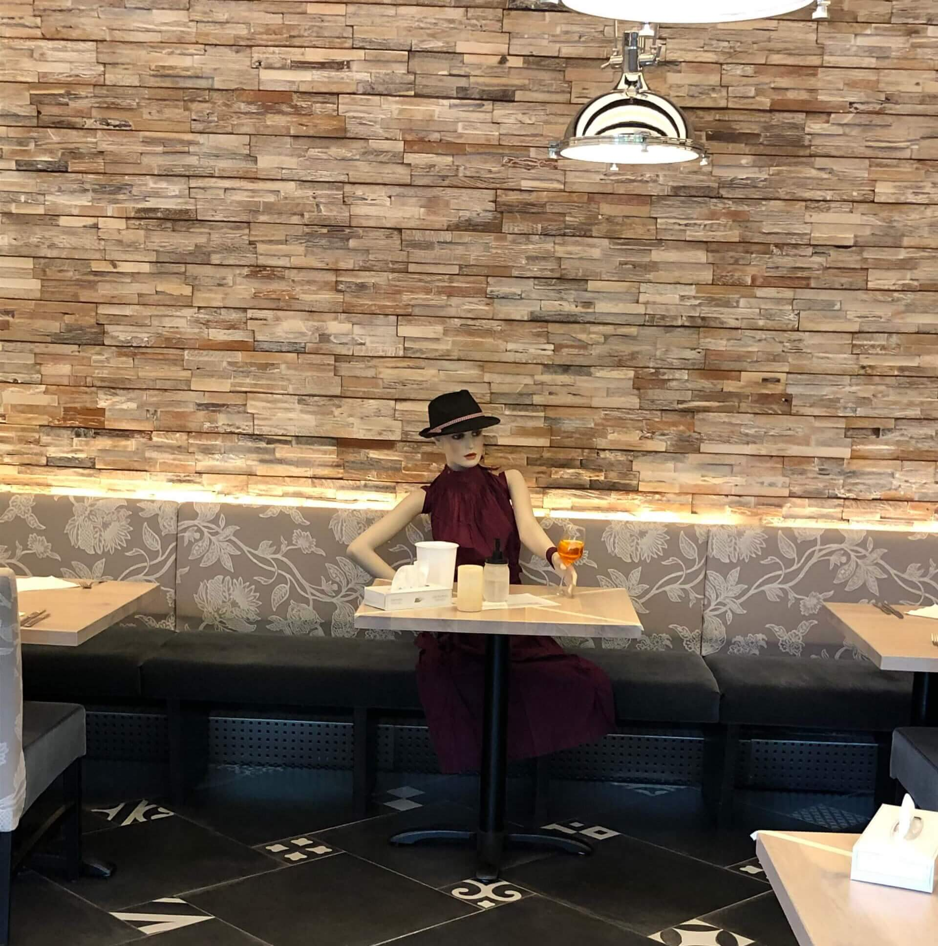 mannequin in a restaurant to keep distance during Corona Virus
